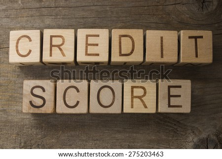 text CREDIT SCORE on a wooden bacground - stock photo