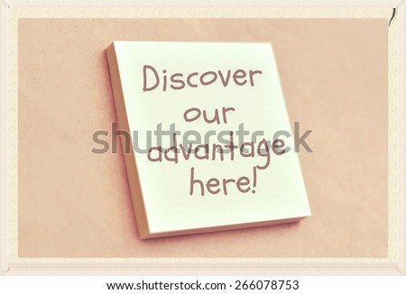 Text discover our advantage here on the short note texture background - stock photo