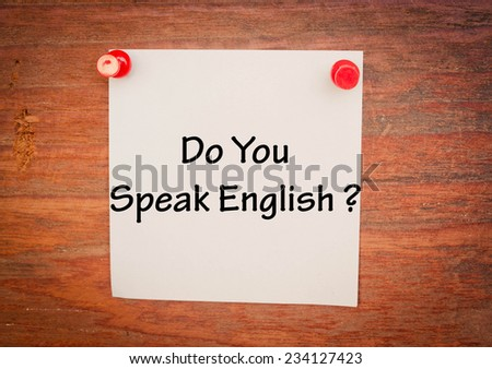 Text do you speak  English on note paper and wood  - stock photo