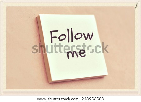 Text follow me on the short note texture background - stock photo