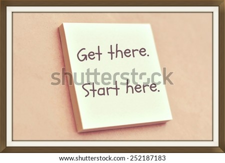 Text get there start here on the short note texture background - stock photo