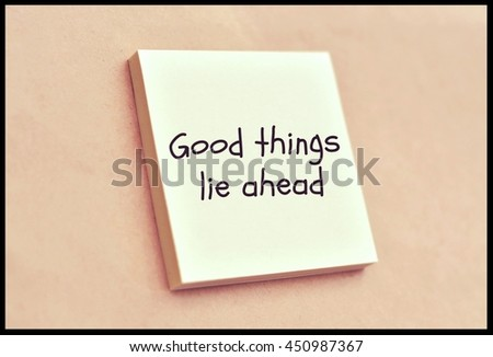 Text good things ahead on the short note texture background - stock photo