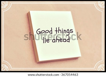 Text good things lie ahead on the short note texture background - stock photo