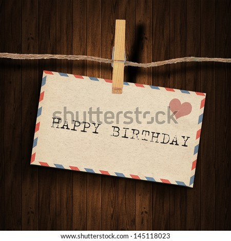 text happy birthday  on the old envelope and clothes peg wood background - stock photo
