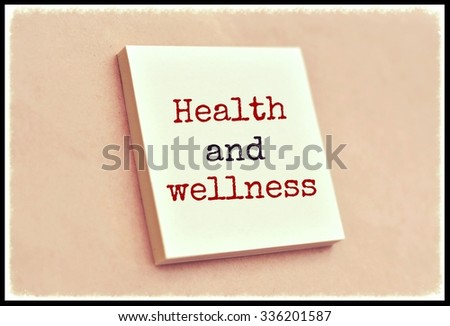 Text health and wellness on the short note texture background - stock photo