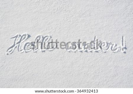 Text HELLO WINTER hand written on snow background. Horizontal postcard template. - stock photo