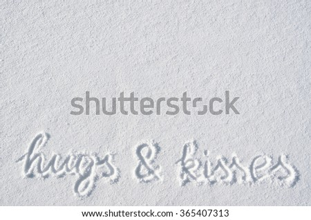 Text hugs and kisses hand written on snow background. Horizontal valentines postcard template. Space for copy, lettering. - stock photo