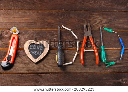 text I love you dad made with DIY tools on wooden background for father`s day - stock photo