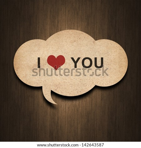 text i love you on speech bubble paper on wood background - stock photo