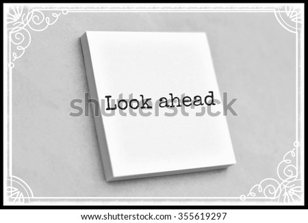 Text look ahead on the short note texture background - stock photo