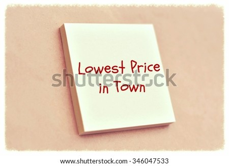 Text lowest price in town on the short note texture background - stock photo