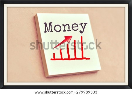 Text money on the graph goes up on the short note texture background - stock photo