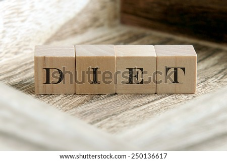 text of DIET on wooden cubes - stock photo