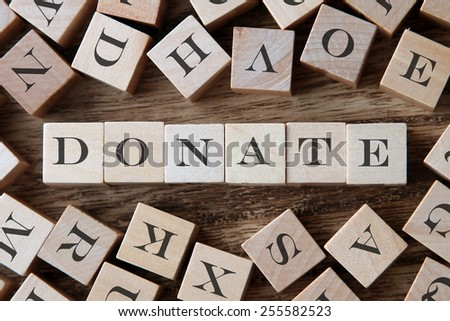 text of DONATE on cubes - stock photo