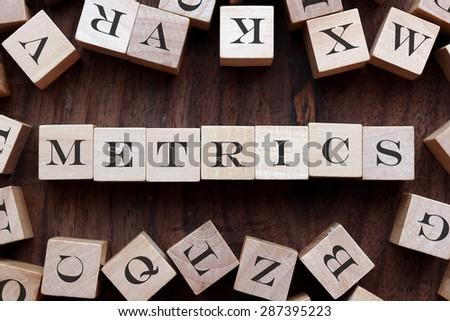text of METRICS on cubes - stock photo