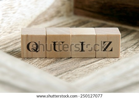 text of QUIZ on wooden cubes - stock photo