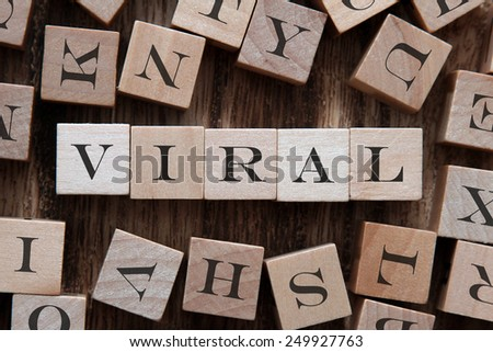 text of VIRAL on cubes - stock photo