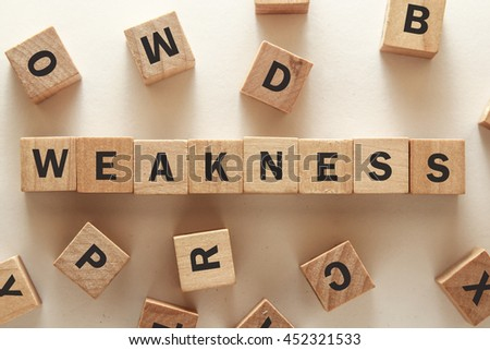 text of WEAKNESS on cubes   - stock photo