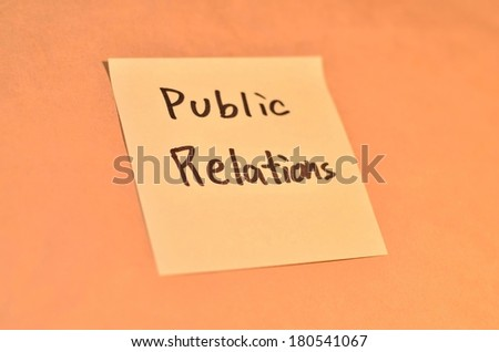 Text public relations on the short note texture background - stock photo