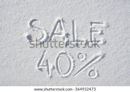 Text SALE 40% hand written on snow background. Horizontal postcard template. - stock photo