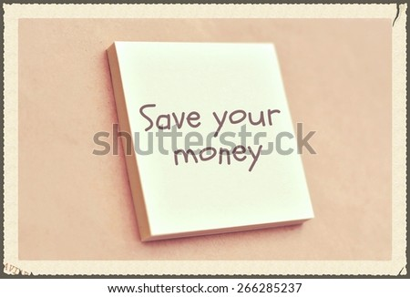 Text save your money on the short note texture background - stock photo