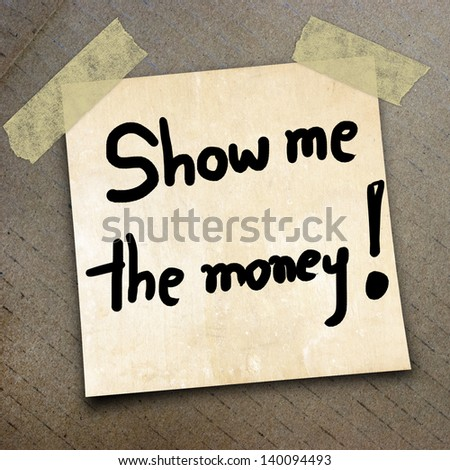 Text Show me the money on the packing paper box texture background - stock photo