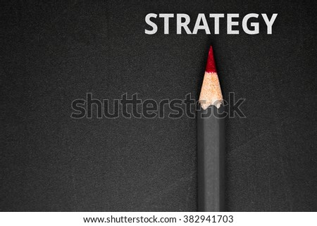 Text Strategy with pencil on black background / business concept - stock photo