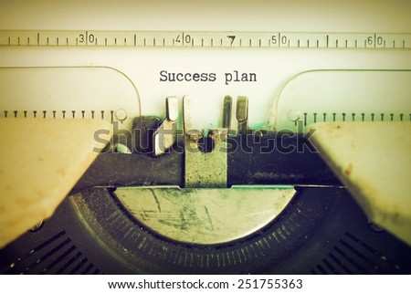 text Success plan on vintage typewriter vintage color tone - stock photo