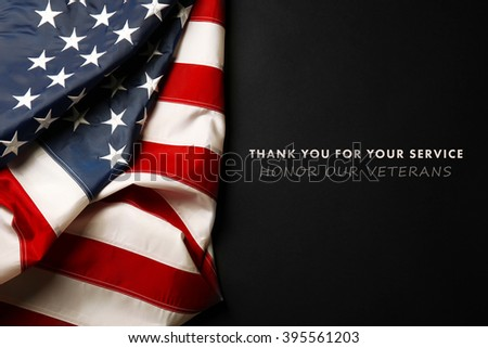 Text Thank You For Your Service on black background near American flag - stock photo