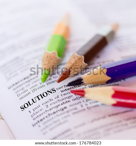 Text the word SOLUTIONS - stock photo