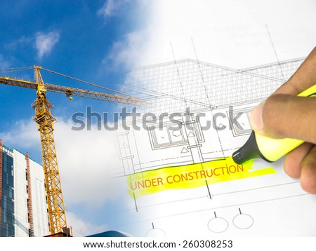 Text ''under construction''  overblurred architectural blueprint of office building - stock photo