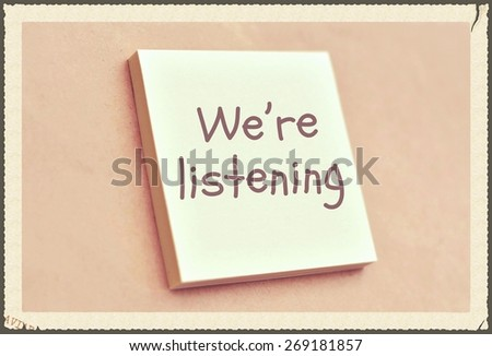 Text we are listening on the short note texture background - stock photo