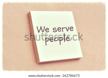 Text we serve people on the short note texture background - stock photo