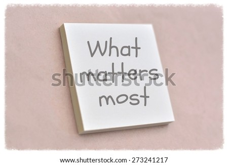 Text what matters most on the short note texture background - stock photo