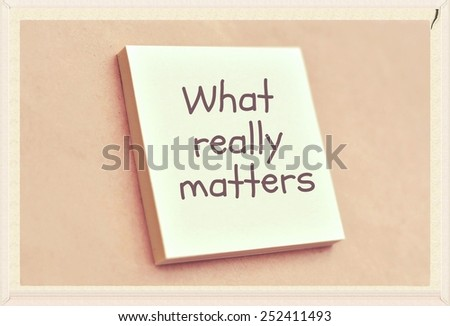 Text what really matters on the short note texture background - stock photo