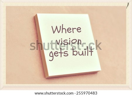 Text where vision gets built on the short note texture background - stock photo