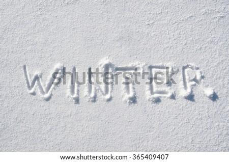 Text WINTER hand written on snow background. Horizontal postcard template. - stock photo