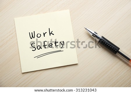 Text Work Safety written on the sticky note with pen aside. - stock photo