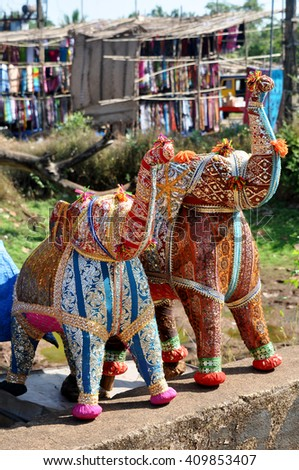 Textile elephants with trunks up - stock photo