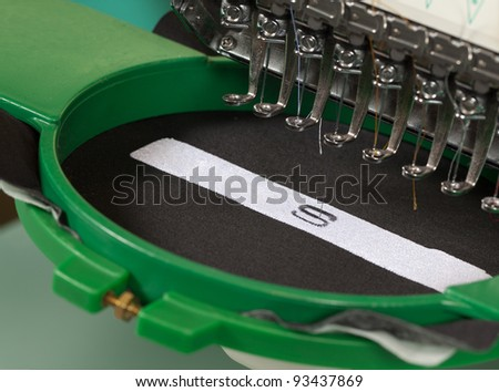 Textile embroidery machine in Textile Industry - stock photo