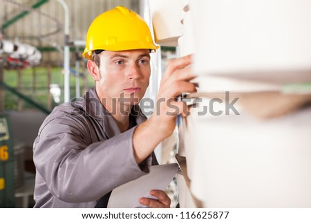 textile industrial worker checking raw material - stock photo