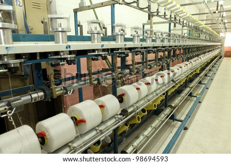 Textile industry (denim) - Weaving and warping - stock photo