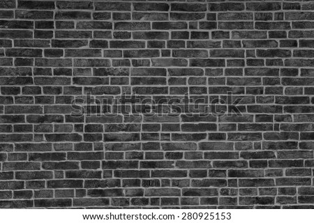 Texture a dark brick wall for backgrounds - stock photo