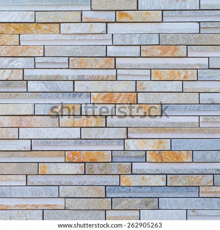 Texture and seamless background of brown granite stone block wall  - stock photo