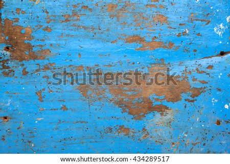 texture/background - blue wooden board with chipping paint and scratches - stock photo