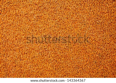 Texture background of the yellow plastic doormat. - stock photo