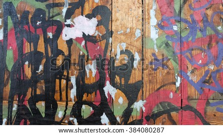 Texture background. Old wall with graffiti. Abstract street pattern paint. Old wooden wall painted paint - stock photo
