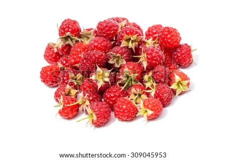texture. background. raspberry  razz  fence  stash.  an edible soft fruit related to the blackberry, consisting of a cluster of reddish-pink drupelets. - stock photo