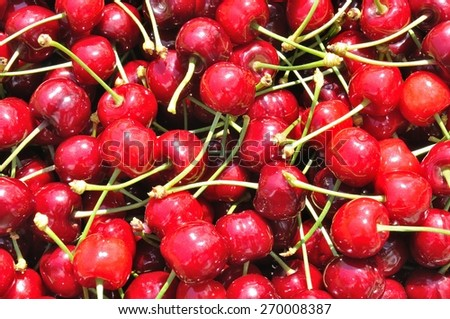 Texture from group of red ripe cherries. Natural background - stock photo