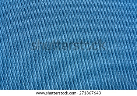 Texture of a blue woven synthetic waterproof fabric                                - stock photo